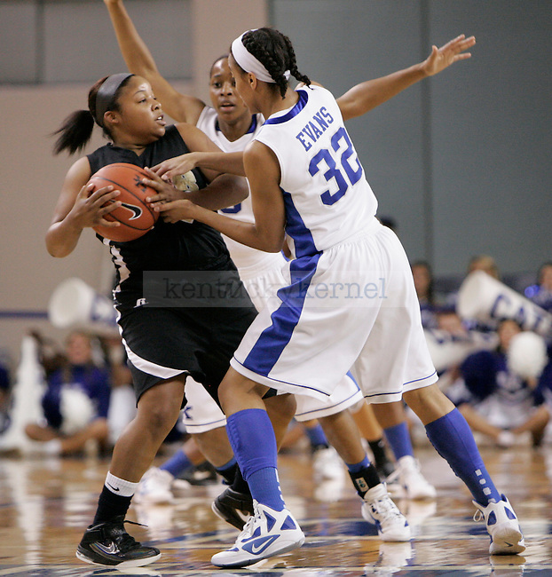 UK guards Crystal Riley and Kastine Evans double team an Arkansas-Pine player during the first half of the UK Women's basketball game against Arkansas- Pine Bluff on 12/11/11 in Lexington, Ky. Photo by Quianna Lige | Staff
