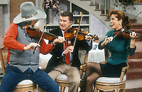 ***FILE PHOTO*** Regis Philbin Passes Away Aged 88.<br /> <br /> Charlie Daniels Regis Philbin Kathy Lee Gifford 1986<br /> <br /> CAP/MPI/PHL/AS<br /> ©AS/PHL/MPI/Capital Pictures