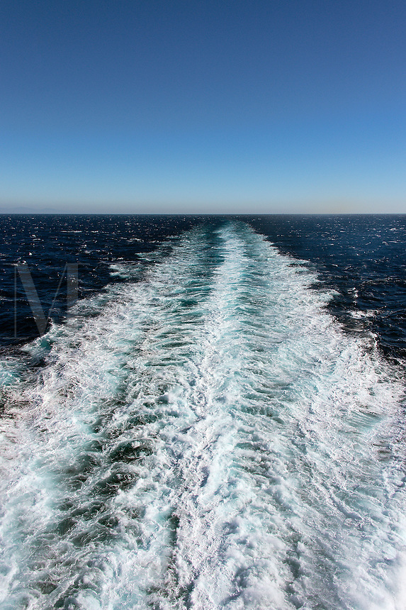 Boat wake on the ocean.