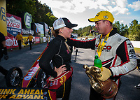 May 5, 2019; Commerce, GA, USA; NHRA top fuel driver Steve Torrence (right) talks with runner up Brittany Force after winning the Southern Nationals at Atlanta Dragway. Mandatory Credit: Mark J. Rebilas-USA TODAY Sports