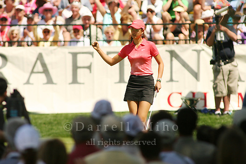 Apr. 2, 2006; Rancho Mirage, CA, USA; Michelle Wie reacts after sinking her birdie putt on the 9th hole which tied her for the lead with Lorena Ochoa (not pictured) in the final round of the Kraft Nabisco Championship at Mission Hills Country Club. ..Mandatory Photo Credit: Darrell Miho.Copyright © 2006 Darrell Miho .