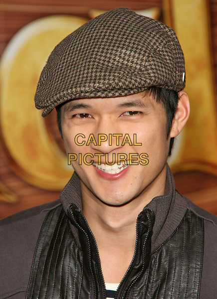 "HARRY SHUM JR..Disney Premiere of ""Tangled"" held at El Capitan Theatre in Hollywood, California, USA..November 14th, 2010.headshot portrait black beige flat cap hat.CAP/RKE/DVS.©DVS/RockinExposures/Capital Pictures."
