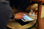 """January 15, 2015, Tokyo, Japan : A customer plays with a cat at the """"Temari No Uchi"""" Cat Cafe in Tokyo, Japan. Temari No Uchi, a Neko Cafe (cat cafe) based in Kichijoji where visitors can watch and interact with 19 cats whilst eating or having a coffee break. The store opened in April 2013 and allows to customers to play with cats and to escape from the stresses of the city life. The entrance fee is 1200 JPY (9.75 USD) on weekdays and 1600 JPY (12.99 USD) on weekend with discounts after 7pm. Drinks and food are charged separately. According to the shop staff most visitors are Japanese women but also men and children visit this cafe. The fist cat cafe in the world opened in Taipei, Taiwan in 1998, and the fist Japanese store was opened in Osaka in 2004. (Photo by Rodrigo Reyes Marin/AFLO)"""