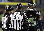 Seattle Seahawks  Richard Sherman (25) looks at the replay on the big screen after he was called for pass interference and questions Field Judge Terry Brown (43) and Umpire Carl Johnson (101) in their game against the Arizona Cardinals at CenturyLink Field in Seattle, Washington on November 15, 2015. The Cardinals beat the Seahawks 39-32.   ©2015. Jim Bryant photo. All Rights Reserved.