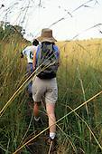 La Lope, Gabon. Tourist in savannah area with guide.