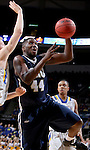SIOUX FALLS, SD - MARCH 5:  Albert Owens #44 of Oral Roberts goes in for a layup during the 2016 Summit League Tournament. (Photo by Dave Eggen/Inertia)