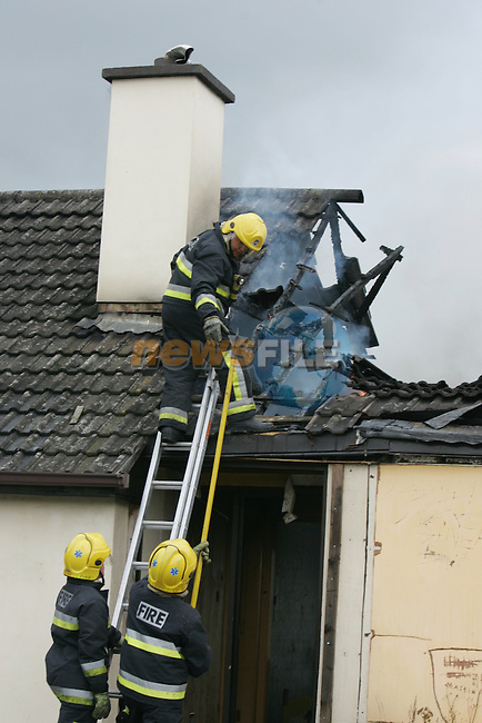 Two units of the Drogheda Fire Service attended a house fire on the Donore Road on Tuesday Evening last, the House which had previously been set on fire was well alight when the fire service arrived the fire was contained in the roof section. The House which had a planing application on the site at the moment is a favourite hide out for local children..Photo: Fran Caffrey/ Newsfile.