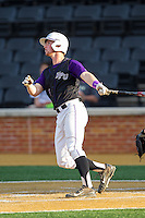 Spencer Angelis (11) of the High Point Panthers follows through on his swing against the Wake Forest Demon Deacons at Wake Forest Baseball Park on April 2, 2014 in Winston-Salem, North Carolina.  The Demon Deacons defeated the Panthers 10-6.  (Brian Westerholt/Four Seam Images)