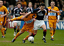 11/03/2006         Copyright Pic: James Stewart.File Name : sct_jspa21_motherwell_v_falkirk.SCOTT MCDONALD IS CHALLENGED BY STEVEN THOMSON...Payments to :.James Stewart Photo Agency 19 Carronlea Drive, Falkirk. FK2 8DN      Vat Reg No. 607 6932 25.Office     : +44 (0)1324 570906     .Mobile   : +44 (0)7721 416997.Fax         : +44 (0)1324 570906.E-mail  :  jim@jspa.co.uk.If you require further information then contact Jim Stewart on any of the numbers above.........