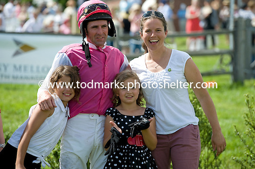 Trainer Regina Welsh celebrates her Radnor Hunt Cup with with Won Wild Bird alongside jockey Richard Boucher and his daughters.