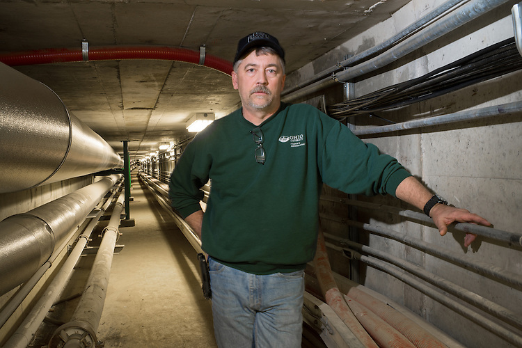 Keith Cox, Chief Engineer Lausche Heating Plant stands in some of the newly rennovated steam tunnels under West Green. Photo by Ben Siegel