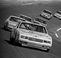 Dale Earnhardt #3 Chevrolet leads pack actio turn 4 Daytona 500 at Daytona International Speedway in Daytona Beach, FL in February 1986. (Photo by Brian Cleary/www.bcpix.com)