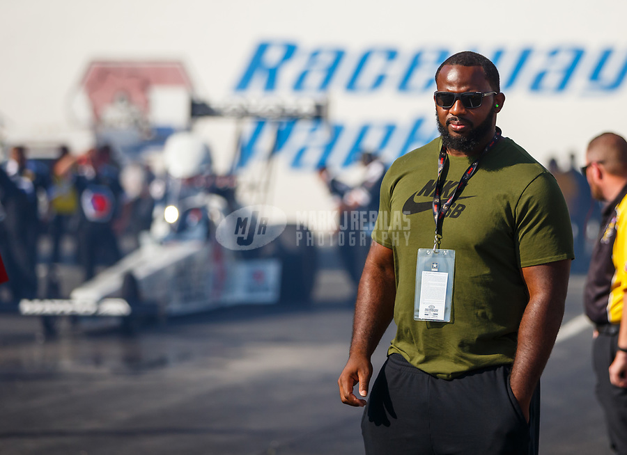 Jun 9, 2017; Englishtown , NJ, USA; Philadelphia Eagles defensive tackle Fletcher Cox watches as NHRA top fuel driver Antron Brown waits to race during qualifying for the Summernationals at Old Bridge Township Raceway Park. Mandatory Credit: Mark J. Rebilas-USA TODAY Sports