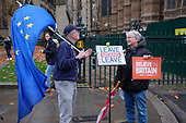 Leave Means Leave.  Pro and anti-Brexit protesters demonstrate outside the Houses of Parliament as MPs debate the government's Brexit deal, Westminster, London.