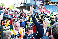 Arsenal manager Arsene Wenger goes out to see the travelling Arsenal fans who were chanting for him after during the Premier League match between Huddersfield Town and Arsenal at the John Smith's Stadium, Huddersfield, England on 13 May 2018. Photo by Thomas Gadd / PRiME Media Images.