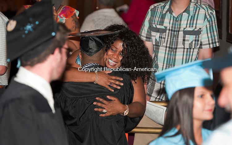 WATERBURY, CT-061714JS08--Graduate Irfan Nasser receives an emotional hug from his mother Fatime Nasser during Waterbury Arts Magnet School's graduation ceremonies Tuesday at the Palace Theater in Waterbury.<br />  Jim Shannon Republican-American