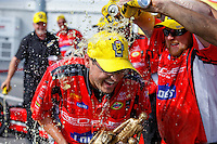 Jun 19, 2016; Bristol, TN, USA; A crew member for NHRA top fuel driver Shawn Langdon is doused with Mello Yello soda as they celebrate after winning the Thunder Valley Nationals at Bristol Dragway. Mandatory Credit: Mark J. Rebilas-USA TODAY Sports