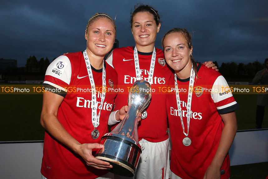 Steph Houghton (L), Jennifer Beattie and Gemma Davison of Arsenal celebrate winning the FAWSL Championship  - Arsenal Ladies vs Doncaster Rovers Belles - FA Womens Super League Football at Boreham Wood FC - 30/09/12 - MANDATORY CREDIT: Gavin Ellis/TGSPHOTO - Self billing applies where appropriate - 0845 094 6026 - contact@tgsphoto.co.uk - NO UNPAID USE.