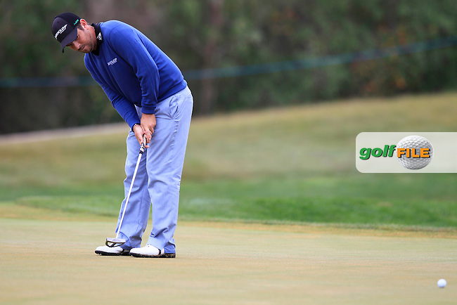 Thomas Aiken (RSA) putts on the 8th green during Saturday's Round 3 of the 2013 Portugal Masters held at the Oceanico Victoria Golf Club. 12th October 2013.<br /> Picture: Eoin Clarke www.golffile.ie