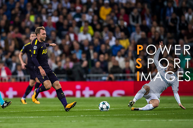 Christian Eriksen of Tottenham Hotspur FC (L) fights for the ball with Luka Modric of Real Madrid  (R) during the UEFA Champions League 2017-18 match between Real Madrid and Tottenham Hotspur FC at Estadio Santiago Bernabeu on 17 October 2017 in Madrid, Spain. Photo by Diego Gonzalez / Power Sport Images