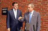 United States President George W. Bush makes a statement to the Travel Pool at the Nebraska Avenue Homeland Security Complex following his tour in Washington, DC on 19 September, 2002.  At left is National Homeland Security Advisor Tom Ridge.<br /> Credit: Ron Sachs / Pool via CNP
