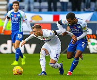 Leeds United's Barry Douglas holds off the challenge from Wigan Athletic's Nathan Byrne<br /> <br /> Photographer Alex Dodd/CameraSport<br /> <br /> The EFL Sky Bet Championship - Wigan Athletic v Leeds United - Sunday 4th November 2018 - DW Stadium - Wigan<br /> <br /> World Copyright &copy; 2018 CameraSport. All rights reserved. 43 Linden Ave. Countesthorpe. Leicester. England. LE8 5PG - Tel: +44 (0) 116 277 4147 - admin@camerasport.com - www.camerasport.com