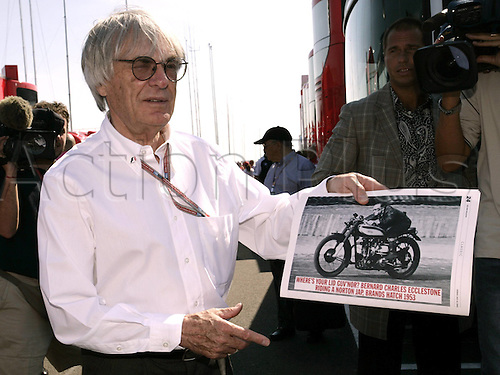 10.07.2005  F1 Chief Bernie Ecclestone (England) with a print of an old motorcycle