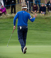 17.10.2014. The London Golf Club, Ash, England. The Volvo World Match Play Golf Championship.  Day 3 group stage matches.  Joost Luiten [NED] holes his putt on the 17th green to go 1 up against Graeme McDowell (NIR).