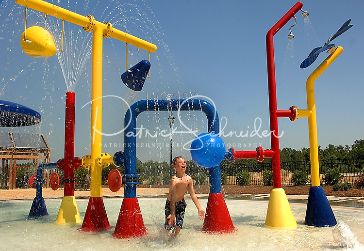 A young boy plays in the water playground at Berewick master-planned community in southwest Mecklenburg County, Charlotte, NC. The property is developed by Pappas Properties.
