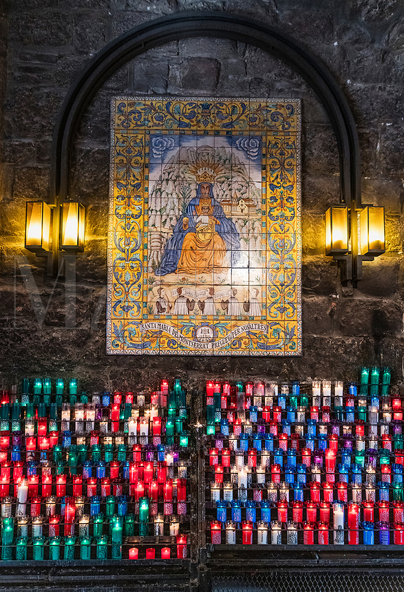 Votive candles to an icon of Santa Maria de Montserrat Abbey, Monistrol de Montserrat,  Catalonia, Spain
