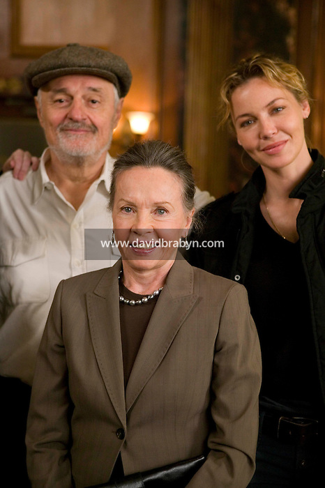 """8 May 2006 - North Bergen, NJ - French actress Leslie Caron (C) poses with Director Ted Kotcheff (L) and Connie Nielsen on the studio set of television show """"Law & Order: SVU"""" in North Bergen, USA, 8 May 2006. In this rare appearance in front of American television cameras, Caron, 74, plays a French victim of past sexual molestation in an episode entitled """"Recall"""" due to air in the fall. Caron starred in Hollywood classics such as """"An American in Paris"""" (1951), """"Lili"""" (1953), """"Gigi"""" (1958). More recently she appeared in """"Chocolat"""" (2000) and """"Le Divorce"""" (2003)."""