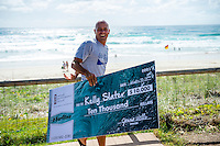 Tugun, Queensland Australia. (Friday March 21, 2014) –  Kelly Slater (USA) being sprayed as he  was presented with two checks this morning for Surfline's 2013 - 2014 Wave of the Winter and 2013 - 2014 US$10,000 Cliff Bar Overall Performance Award of the Winter. Sebastien Zietz (HAW) and Tommy Whitaker (AUS) surprised Kelly by jumping out from behind parked cars spraying him with soda water and presenting the US$25,000 Oakley Wave of the Winter check. Photo: joliphotos.com