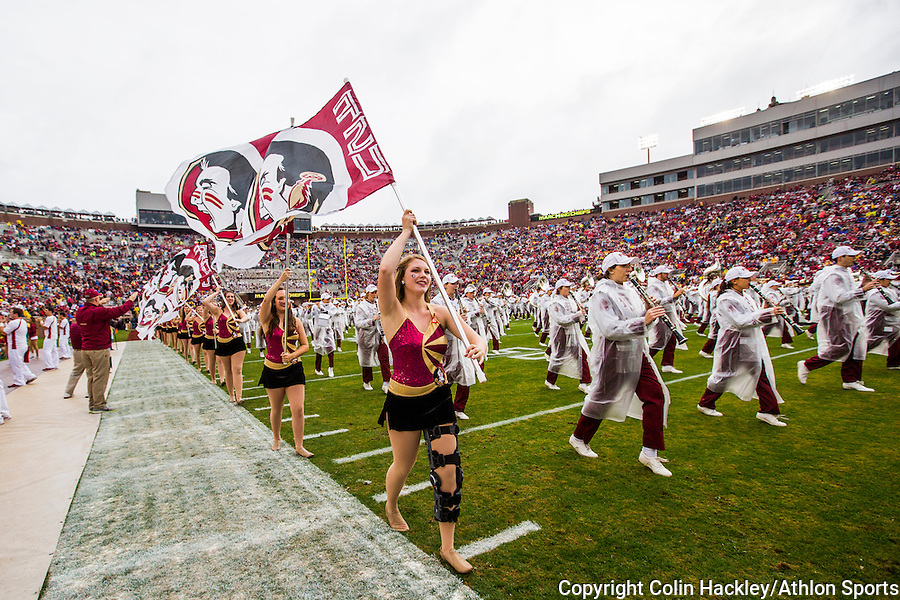 The Florida State University Marching Chiefs band and flag corp take the field prior to the  Seminoles football game against the Boston College Eagles in Tallahassee, Florida on November 22, 2014.  <br /> Colin Hackley/Athlon Sports
