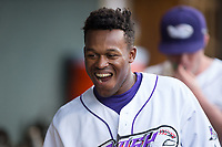 Luis Alexander Basabe (16) of the Winston-Salem Dash is all smiles after scoring a run against the Myrtle Beach Pelicans at BB&T Ballpark on May 11, 2017 in Winston-Salem, North Carolina.  The Pelicans defeated the Dash 9-7.  (Brian Westerholt/Four Seam Images)