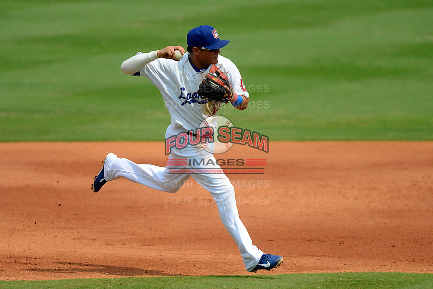 Chattanooga Lookouts shortstop Miguel Rojas #13 throws to first during a game against the Birmingham Barons on April 17, 2013 at AT&T Field in Chattanooga, Tennessee.  Chattanooga defeated Birmingham 5-4.  (Mike Janes/Four Seam Images)