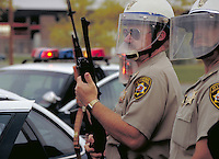 Wyoming Highway Patrolmen in riot gear, police officers, armed cops, artillery, intimidation. Casper Wyoming USA.