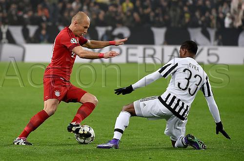23.02.2016. Turin, Italy. UEFA Champions League football. Juventus versus Bayern Munich.  Arjen Robben (FC Bayern Mun), Patrice Evra (Juventus)