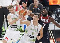 Slovenia's Zoran Dragic (l) and Jure Balazic (c) and USA's Kenneth Faried during 2014 FIBA Basketball World Cup Quarter-Finals match.September 9,2014.(ALTERPHOTOS/Acero)