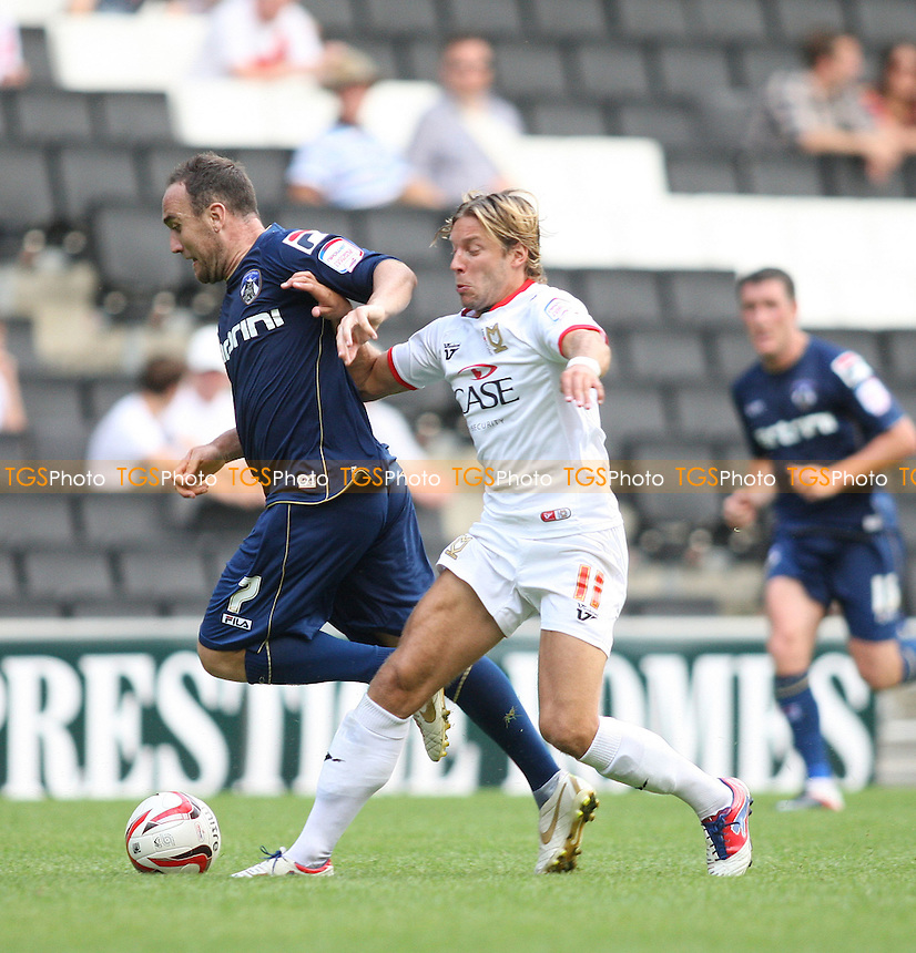 Alan Smith of MK Dons challenges Lee Croft of Oldham Athletic- MK Dons vs Oldham Athletic - NPower League One Football at Stadium MK, Milton Keynes - 18/08/12 - MANDATORY CREDIT: George Phillipou/TGSPHOTO - Self billing applies where appropriate - 0845 094 6026 - contact@tgsphoto.co.uk - NO UNPAID USE.