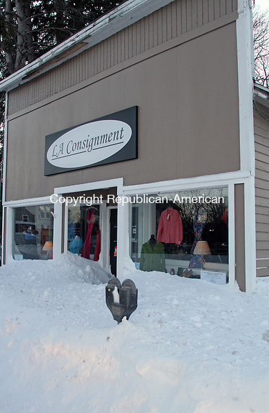 Torrington, CT-020913MK03 Storefronts are buried after the heavy snowbank along Main Street in Torrington on Saturday after the storm that dropped over 15 inches in Litchfield County.  The forecast is predicting calm weather today. Michael Kabelka / Republican-American