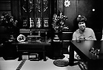 Yuriko sits and stays next to the altar of her mother. Her mother was pregnant with Yuriko when the atomic bomb hit her in Hiroshima. ..August 2002.