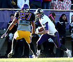 MANKATO, MN - NOVEMBER 1:  Erik Albeck #6 for the University of Sioux Falls eyes the defense of Rob Myers #27 from Minnesota State Mankato in the fourth quarter Saturday afternoon at Blakeslee Stadium in Mankato. (Photo by Dave Eggen/Inertia)