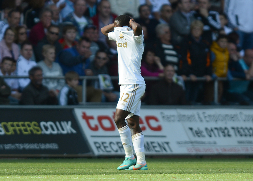 Swansea City's Nathan Dyer walks off after being shown the Red Card by Referee Anthony Taylor ..Football - Barclays Premiership - Swansea City v Everton - Saturday 22nd September 2012 - Liberty Stadium - Swansea..