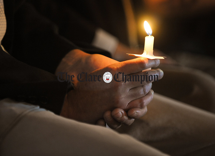 Captain Alan Lendrum's relative Geoff Simmons holds a candle during a service of reconciliation as part of the 90th anniversary commemoration of the deaths of Commandant Willie Shanahan, Captain Alan Lendrum MC and Captain Michael ..Mc Namara. Photograph by John Kelly.........