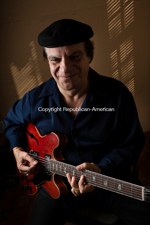 WATERBURY, CT- 19 October 2015-101915EC08-  Guitarist Tony Purrone practices at his Waterbury home. Erin Covey Republican-American
