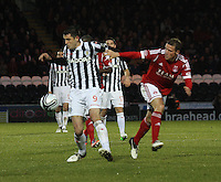 Steven Thompson gets to the ball before Chris Clark in the St Mirren v Aberdeen Clydesdale Bank Scottish Premier League match played at St Mirren Park, Paisley on 9.11.12.