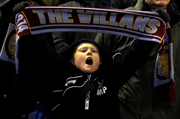 An Aston Villa fan chants during the game.<br /> <br /> Photo by James Marsh/CameraSport<br /> <br /> Football - Barclays Premiership - West Bromwich Albion v Aston Villa - Monday 25th November 2013 - The Hawthorns - West Bromwich<br /> <br /> &copy; CameraSport - 43 Linden Ave. Countesthorpe. Leicester. England. LE8 5PG - Tel: +44 (0) 116 277 4147 - admin@camerasport.com - www.camerasport.com