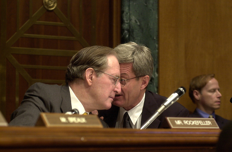 1trade062101 -- Senate Finance Committee chairman Max Baucus, D-Mont., and John D. Rockefeller, D-W.Va., talk during the hearing on trade promotion authority.