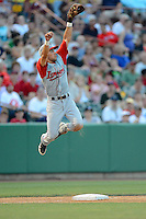 Lowell Spinners third baseman Carlos Asuaje (15) jumps to catch a wild throw during a game against the Tri-City ValleyCats on July 5, 2013 at Joseph L. Bruno Stadium in Troy, New York.  Tri-City defeated Lowell 5-4.  (Mike Janes/Four Seam Images)