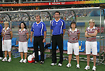 18 August 2008: Germany's technical staff. From left: Head coach Silvia Neid (GER), assistant coach Ullrike Ballweg (GER), goalkeeping coach Michael Fuchs (GER), and staff.  The women's Olympic soccer team of Brazil defeated the women's Olympic soccer team of Germany 4-1 at Shanghai Stadium in Shanghai, China in a Semifinal match in the Women's Olympic Football competition.
